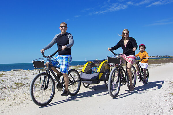 Miami family riding bikes on beach