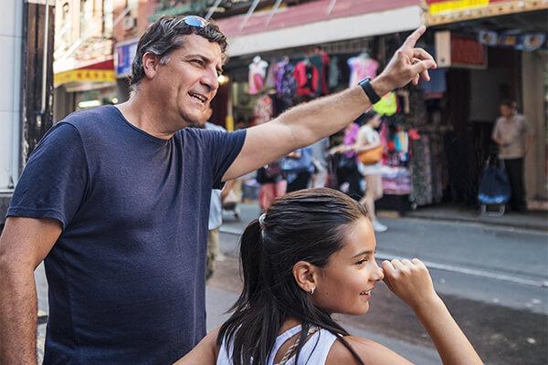New York City family hailing cab