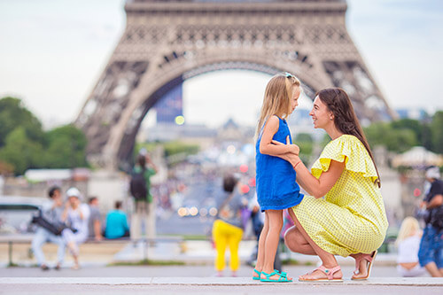 Paris family in front of Eiffel Tower